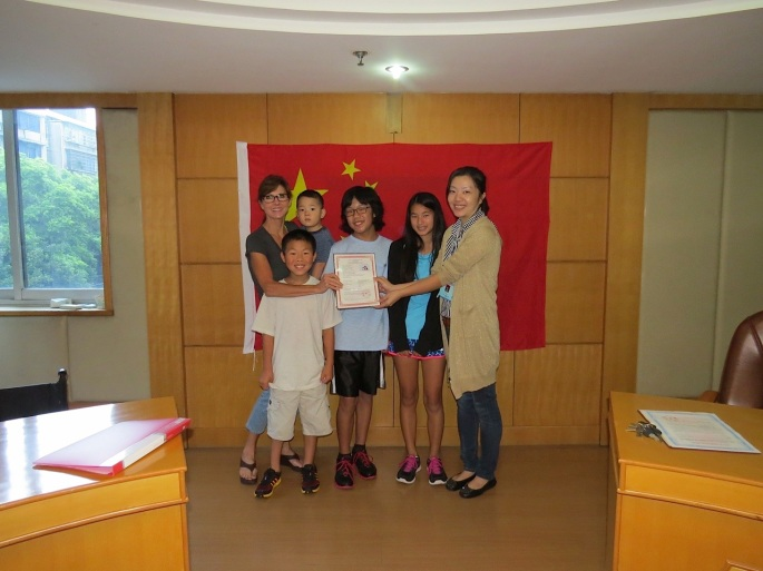 In China for Jay's adoption with Jane and older siblings Matthew (Front left), David (center) and Claire (second from right).