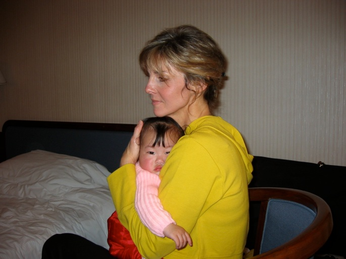 Jane holding her daughter Claire shortly after receiving her in China (2002).