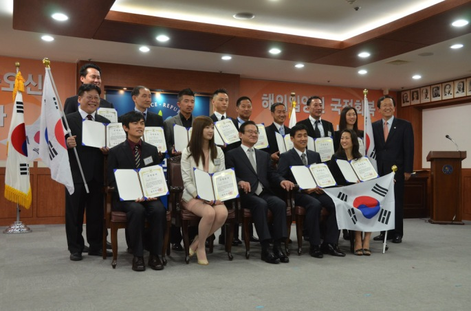The first 13 Korean adoptees receiving dual citizenship in Korea pose for a photo at a special ceremony held for them in April 2011. Dual citizenship in Korea for adoptees was made possible through lobbying efforts led by adoptee activists. (Photo courtesy of G.O.A.'L.)