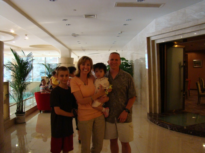 Olivia meets her adoptive parents and brother for the first time in China.